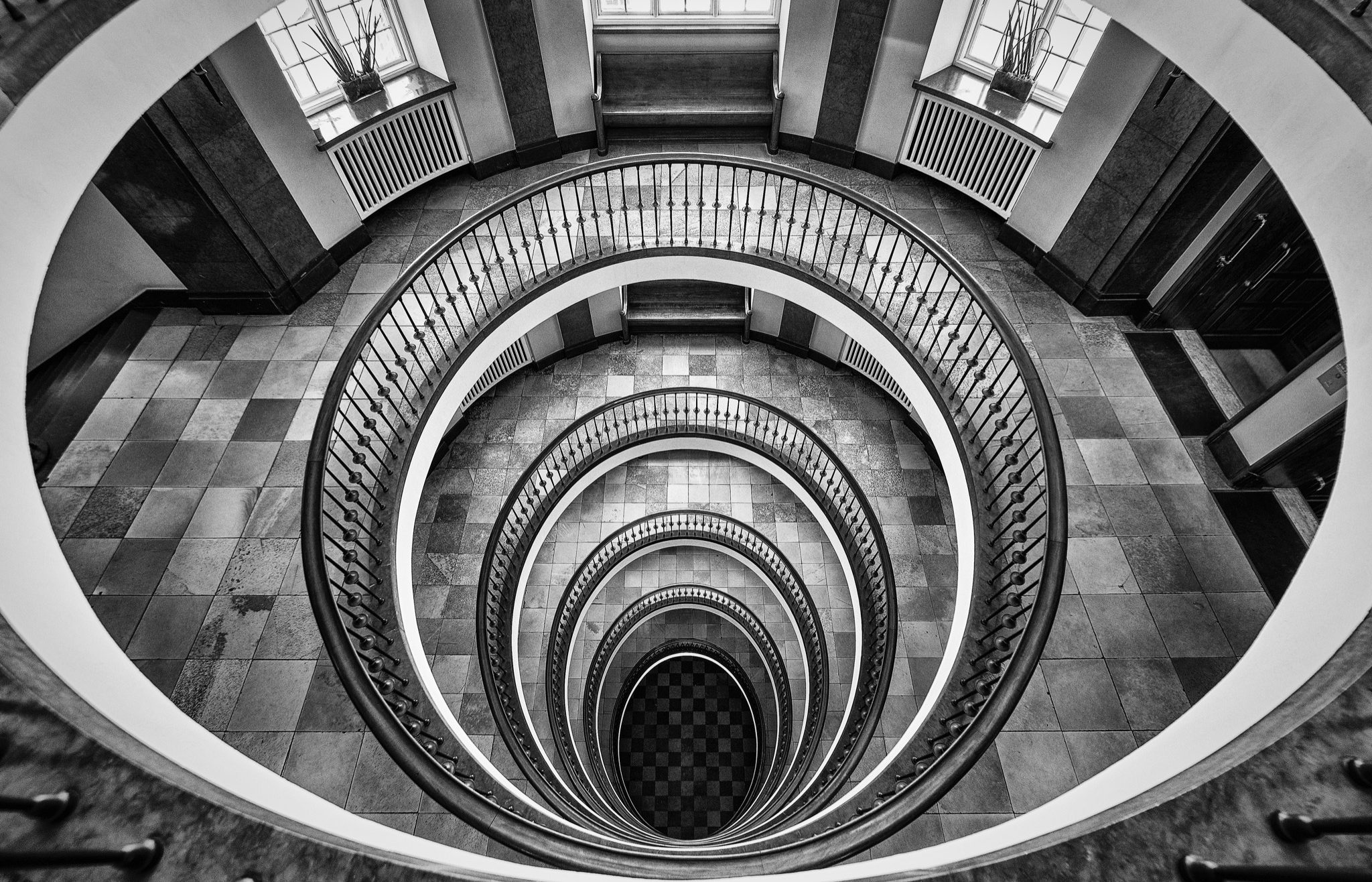 The iconic open oval staircase platforms in Axelborg Tower in Copenhagen.